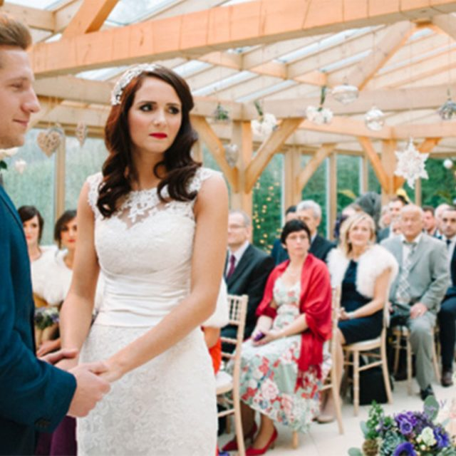 Bride and groom exchanging vows in the Orangery at Christmas – wedding venues in Essex