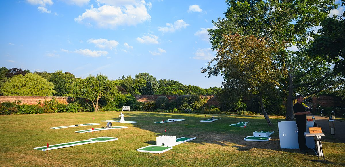 A selection of outdoor wedding games are laid on the lawns for an outdoor wedding reception at Gaynes Park