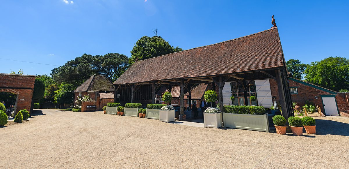 The Gather Barn at Gaynes Park is the perfect spot for an outdoor wedding ceremony