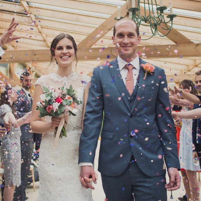 Confetti shot of bride and groom inside the Orangery at Gaynes Park wedding venue