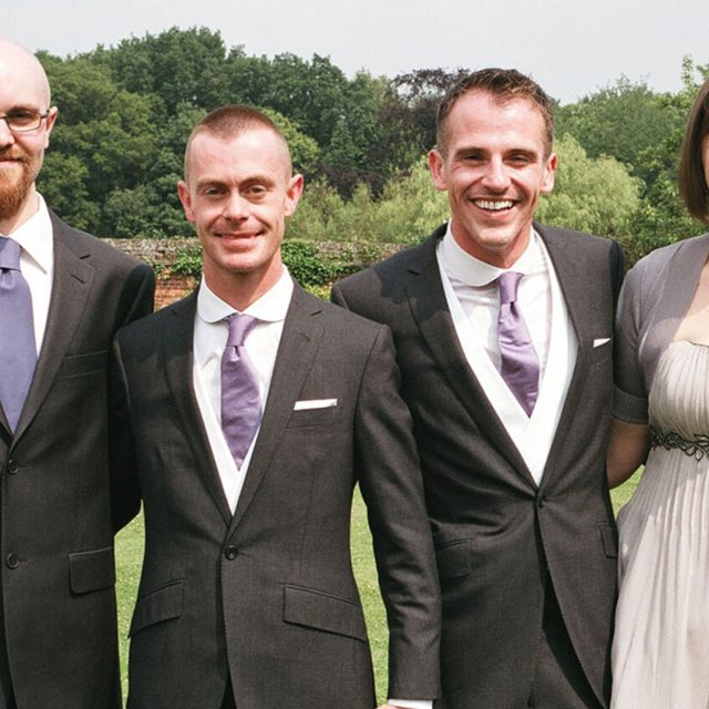 Grooms with their friends in the gardens of Gaynes Park