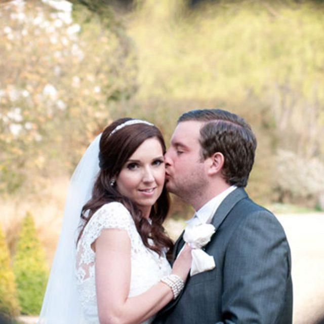 Bride and groom through the heart gate at Gaynes Park – wedding barn Essex