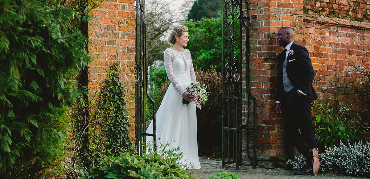 Newlyweds make the most of the gardens at Gaynes Park for their wedding photographs