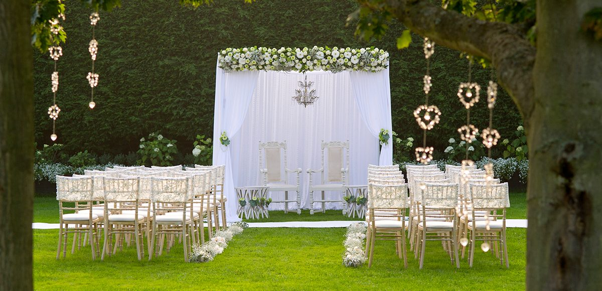 The Walled Gardens at Gaynes Park are set up for an outdoor wedding ceremony