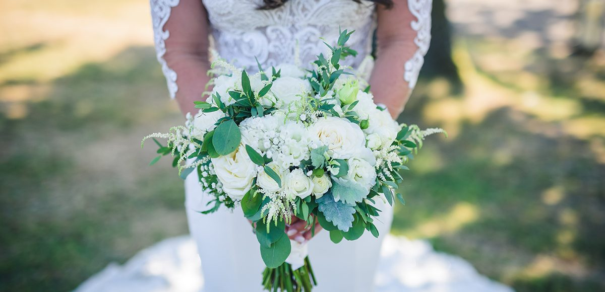 White florals are a great way to ooze elegance for a white wedding at Gaynes Park