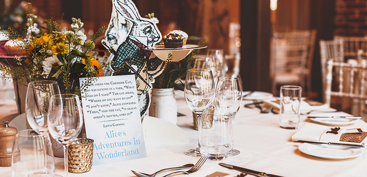 An Alice in Wonderland wedding table centrepiece worked well for this summer wedding at Gaynes Park