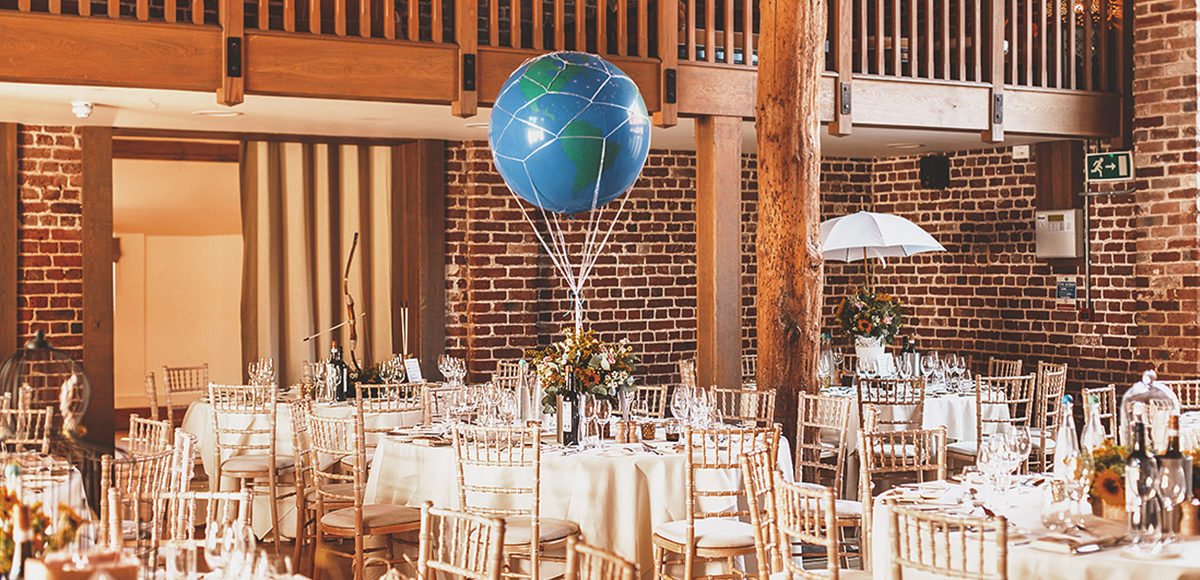 A couple chose props to create alternative wedding table centrepieces for their summer wedding at Gaynes Park