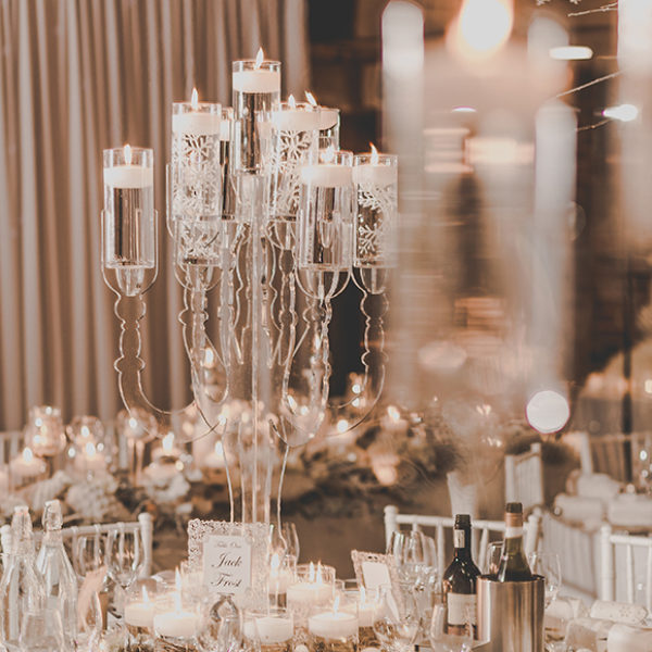 A clear candelabra creates a romantic wedding centrepiece for a winter wedding at Gaynes Park