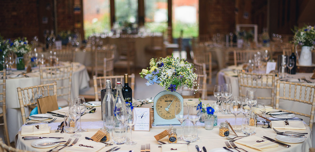 A brides love of baking came through in her wedding centrepiece at Gaynes Park when she used a set of scales to hold flowers